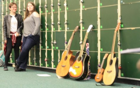 The gorgeous guitars sitting against the lockers.