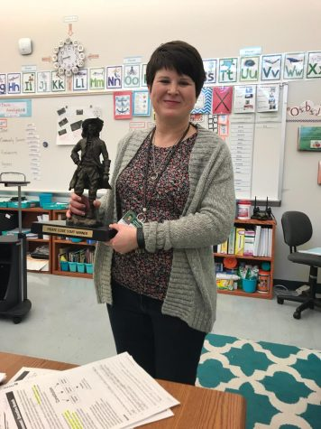 mrs. Parish posing with the Pirate Pete Trophy.