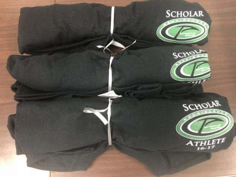 Renaissance Club passes out Scholar Athlete T-shirts for spring sports season