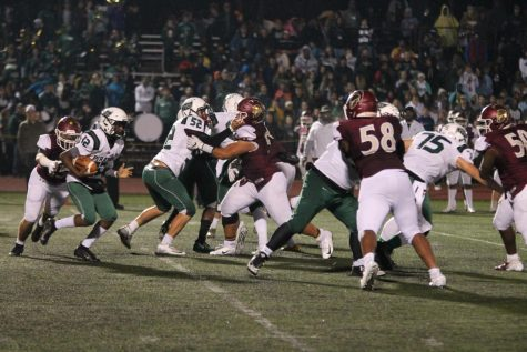 Quarterback Andre Webb carries the ball against the De Smet defense in a playoff game on Nov. 2.