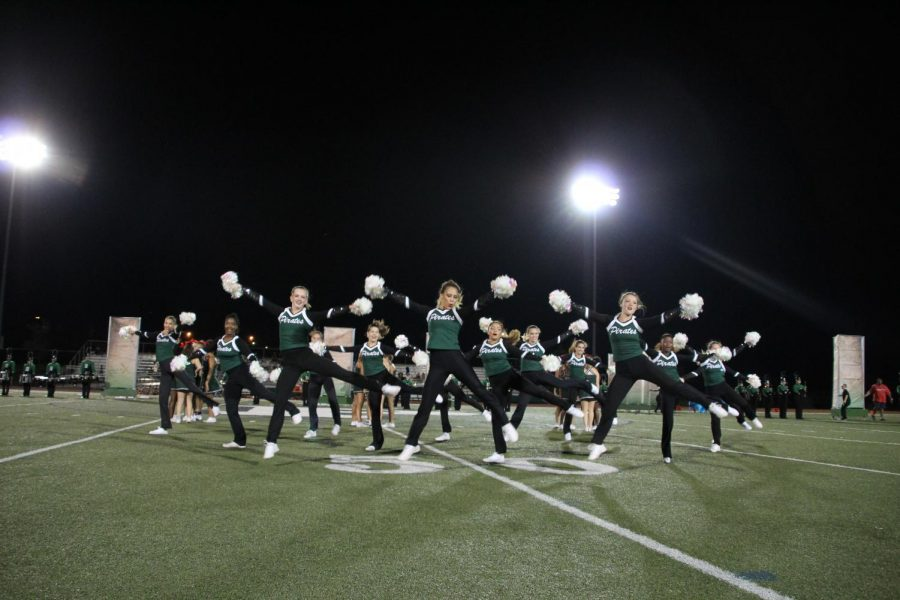 The+Varsity+Drill+Team+performs+at+a+football+game+during+the+fall+season.