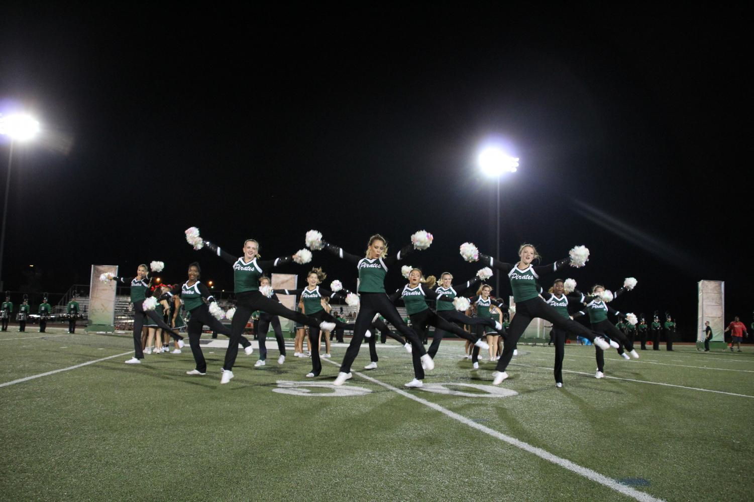The Varsity Drill Team performs at a football game during the fall season.
