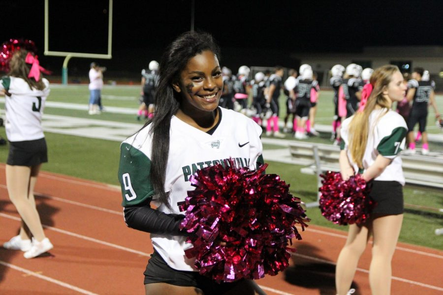 Senior+Makayla+Harden+cheers+on+the+sideline+of+a+football+game.+She+was+selected+as+an+All-State+cheerleader+during+their+state+competition+on+Dec.+1.