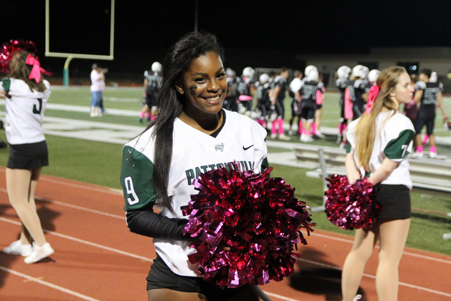 Senior Makayla Harden cheers on the sideline of a football game. She was selected as an All-State cheerleader during their state competition on Dec. 1.