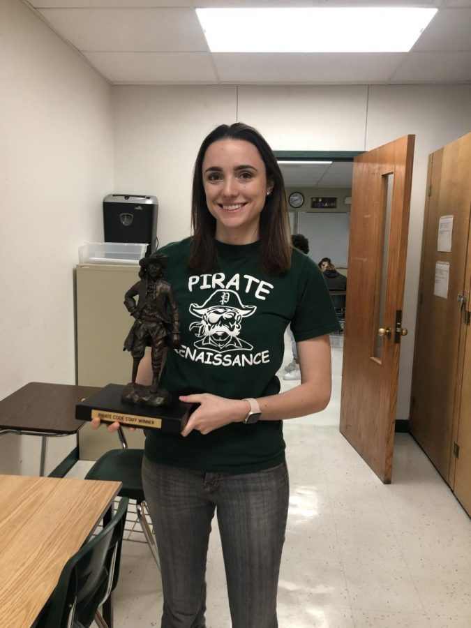 Ms. Trista Giubardo with the Pirate Code Staff Winner trophy.