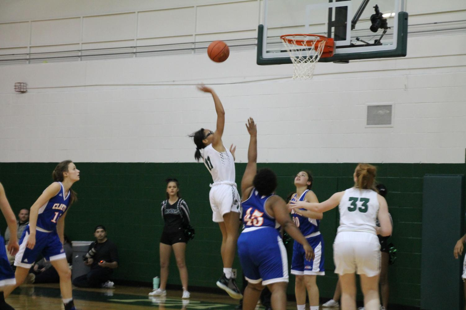 Pattonville's Brooke Jenkins shoots a floater over Clayton's Aniah Arms.