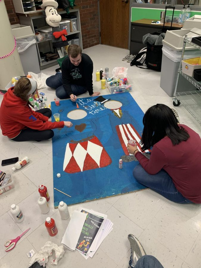 STUCO members prepare for Night to Shine by painting a