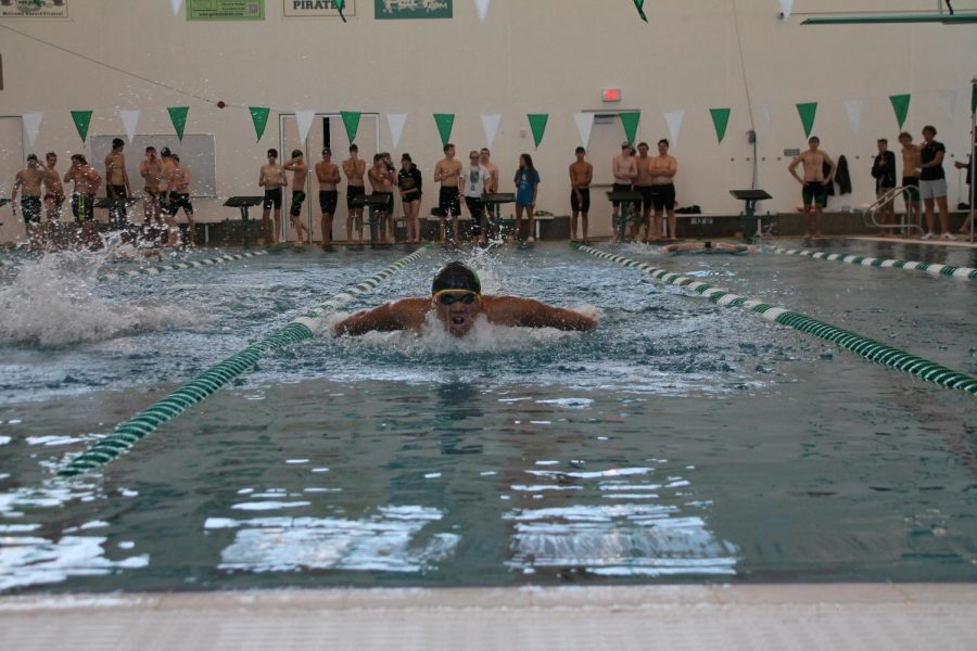 Spreading his wings, Philip Tso qualifies for state in the 100m butterfly.