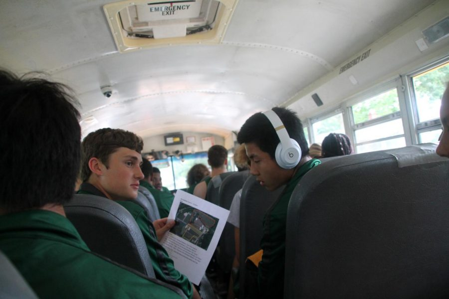 On their way to the first Cross Country meet, Justin Bowers and Kai Mills examine the trail.