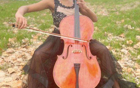 Kenedi Jenkins practicing her cello outside during the Quarantine Break.