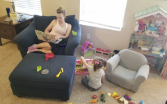 Ms. Kessler publishes her weekly lesson plans from home while her three year old daughter tries to get her attention.