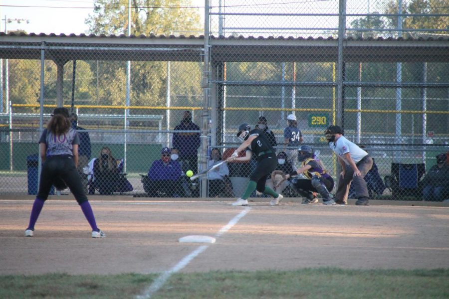Maddie Bailey batting in the final inning against Affton High School on Monday, October 5. Pattonville ended up winning the game with a score of 19-10.