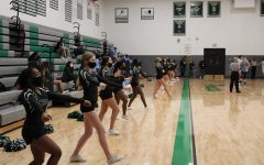 PHS Cheerleaders perform at a boys' varsity basketball game against Parkway West. The Pirates went on to win 47-33.