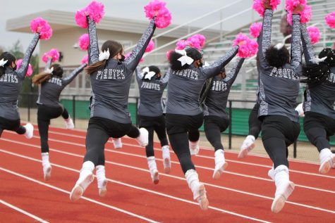 Varsity Drill Team continued to cheer along side Marching Band and Varsity Cheer at a soccer game.