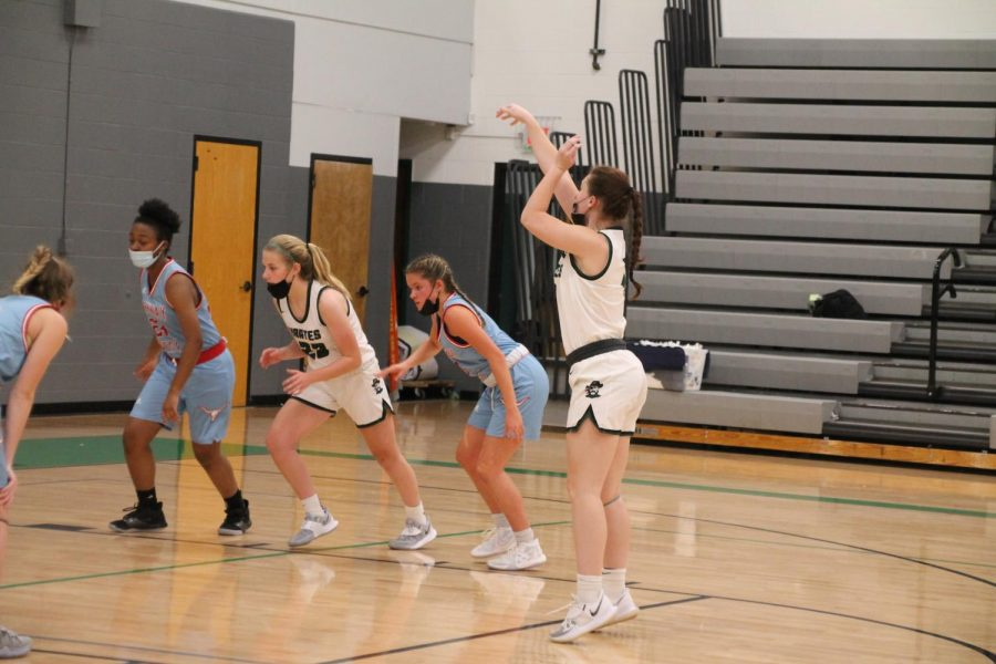 Charlie Heiligenstein throws a free throw in Pattonvilles home game against Parkway West on December 11, while Mattie Ohlsen gets ready to catch the rebound.