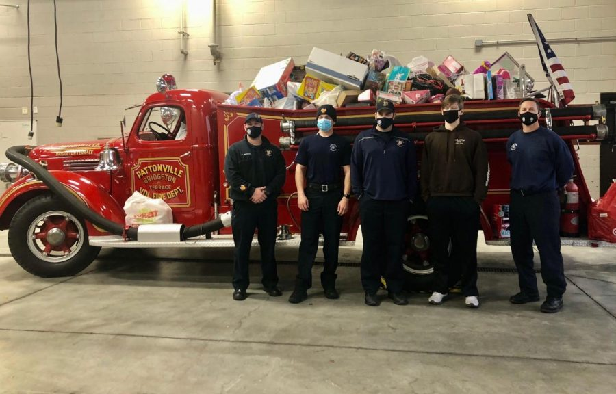 Jaxon Luraschi with Pattonville Firefighters. The Pattonville Community donated over 100 toys, filling the fire truck.