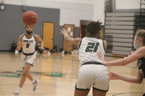 Alex Bullard passes the ball to her teammate, Jasmine Grey, in their game against St. Charles High on January 15th.
