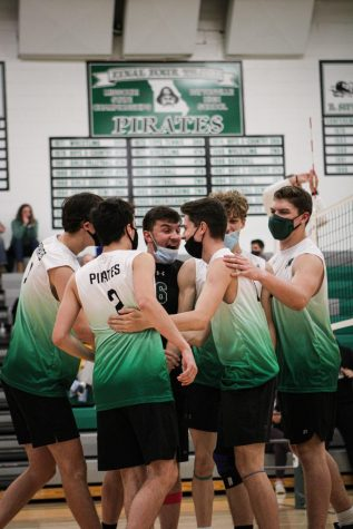 After a point-winning kill, Zach Noles is congratulated by his teammates. The Varsity Boys Volleyball Team is currently undefeated, with a 28-0 record.