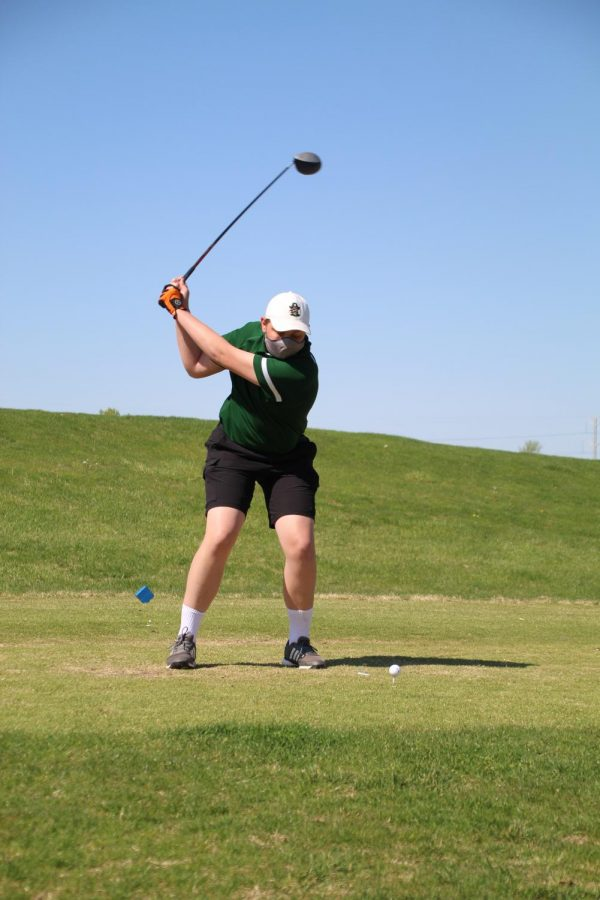 Bryan Burns (12) tees off toward the end of his match. Bryan earned 3rd team all-conference honors this season.