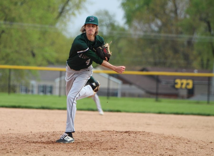 """Zachary Williams (12) pitches the ball to the opponent from Liberty High School. """"The most important thing when pitching is getting ahead in the count and working the strike zone,"""" said Williams."""