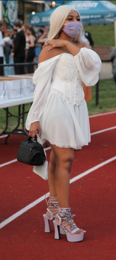 Jadyn Graves wore a white corset style dress to Pattonville's Senior Prom on May 7, 2021. The dress's top hearkens to a previous era in a new way.