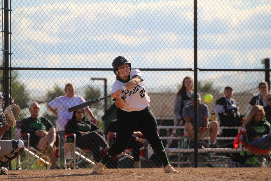 Samantha Newton lines up for a hit, as focused on the ball while hitting as she is catching.