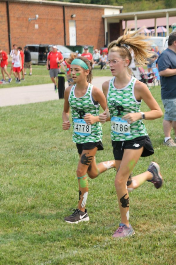 During the Stan Nelson Invitational 5k Charley Bennight finishes with a time of 25:26. Placing 37th for jv girls.