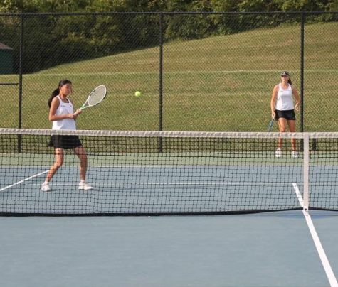 During a doubles match, players work together to figure out how to defeat their opponents. The girls faced Francis Howell North on September 24.