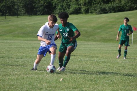 Noeal Arefaine fights a Duchesne player for the ball in the game on September 7. The Pirates went on to win, 2-0.